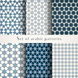 Set of seamless symmetrical abstract vector background in arabian style. Made of geometric shapes. Islamic traditional patterns. Blue, grey and white colors Royalty Free Stock Photo