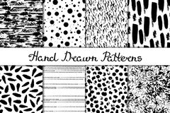 Set of 8 seamless texture. Chaotic, prints, droplets, stripes, spots, dots. Abstract forms drawn a wide pen and ink. Backgrounds i. N black and white. Hand drawn Stock Photography