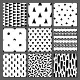Set of 9 seamless texture. Drops, points, lines, stripes, circles, squares, rectangles. Abstract forms drawn a wide pen and ink. Backgrounds in black and white Stock Images