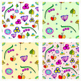 Set of seamless vector childlike floral patterns. Cute hand drawn endless backgrounds with childish flowers and leaves. Series of Stock Photography
