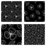 Set of seamless vector floral patterns. Black and white hand drawn background with flowers, leaves, decorative elements. Graphic i Royalty Free Stock Image