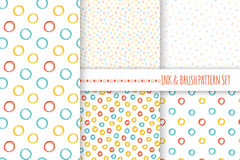 Set of seamless vector free hand multicolored baby doodle polka dot and circle textures, dry brush ink art. Royalty Free Stock Photo