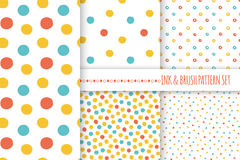 Set of seamless vector free hand multicolored baby doodle polka dot and circle textures, dry brush ink art. Royalty Free Stock Image