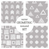 Set of seamless vector geometrical patterns with triangles, circle, squares. Grey pastel endless background with hand drawn textur Stock Image
