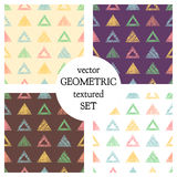 Set of seamless vector geometrical patterns with triangles. pastel endless background with hand drawn textured geometric figures. Stock Image