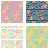 Set of seamless vector geometrical patterns with triangles. pastel endless background with hand drawn textured geometric figures. Stock Images