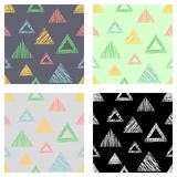Set of seamless vector geometrical patterns with triangles. pastel endless background with hand drawn textured geometric figures. Royalty Free Stock Photos