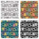 Set of seamless vector geometrical patterns with triangles. pastel endless background with hand drawn textured geometric figures. Royalty Free Stock Photo