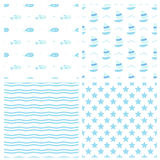 Set of seamless vector patterns for baby boy in marine style. Cute fishes, boats starfish and waves Stock Images