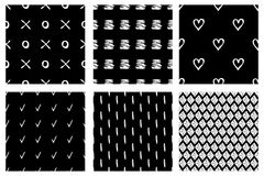 Set of seamless vector patterns. Black and white geometrical endless backgrounds with hand drawn geometric shapes, triangles, circ Stock Images