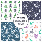 Set of seamless vector patterns with cute hand drawn fir trees, gifts, hearts, bows, christmas toys. Seasonal winter backgrounds G. Raphic illustration Stock Image