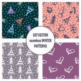 Set of seamless vector patterns with cute hand drawn fir trees, gifts, hearts, bows, christmas toys. Seasonal winter backgrounds G Stock Photos