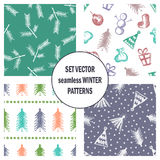 Set of seamless vector patterns with cute hand drawn fir trees, gifts, hearts, bows, christmas toys. Seasonal winter backgrounds G. Raphic illustration Royalty Free Stock Photography