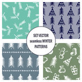 Set of seamless vector patterns with cute hand drawn fir trees, gifts, hearts, bows, christmas toys. Seasonal winter backgrounds G Royalty Free Stock Images