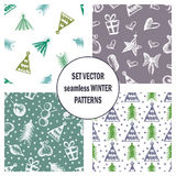 Set of seamless vector patterns with cute hand drawn fir trees, gifts, hearts, bows, christmas toys. Seasonal winter backgrounds G Royalty Free Stock Photography