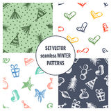 Set of seamless vector patterns with cute hand drawn fir trees, gifts, hearts, bows, christmas toys. Seasonal winter backgrounds G Stock Image