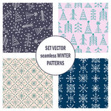 Set of seamless vector patterns with fir-trees, snowflakes. seasonal winter background with cute hand drawn fir trees Graphic illu. Stration. Series of winter Royalty Free Stock Photography