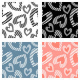 Set of seamless vector patterns. With hearts. Background with hand drawn ornamental symbols. Template for wrapping, decor, surface, cards, backgrounds, textile Stock Photo