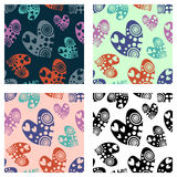 Set of seamless vector patterns with hearts. Background with hand drawn ornamental symbols. Template for wrapping, decor, surface, Stock Images