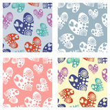 Set of seamless vector patterns with hearts. Background with hand drawn ornamental symbols. Template for wrapping, decor, surface, Royalty Free Stock Photo