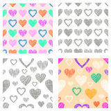 Set of seamless vector patterns with hearts. endless symmetrical backgrounds with hand drawn textured figures. Graphic illustratio Royalty Free Stock Photos