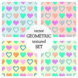 Set of seamless vector patterns with hearts. endless symmetrical backgrounds with hand drawn textured figures. Graphic illustratio Stock Photos