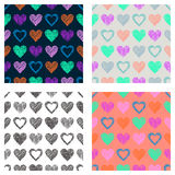 Set of seamless vector patterns with hearts. endless symmetrical backgrounds with hand drawn textured figures. Graphic illustratio. N Template for wrapping, web Royalty Free Stock Photography