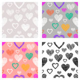 Set of seamless vector patterns with hearts. endless symmetrical backgrounds with hand drawn textured figures. Graphic illustratio. N Template for wrapping, web Stock Photography