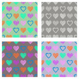 Set of seamless vector patterns with hearts. endless symmetrical backgrounds with hand drawn textured figures. Graphic illustratio. N Template for wrapping, web Royalty Free Stock Image