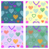 Set of seamless vector patterns with hearts. endless symmetrical backgrounds with hand drawn textured figures. Graphic illustratio. N Template for wrapping, web Stock Image