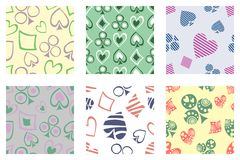 Set of seamless vector patterns with icons of playings cards. Royalty Free Stock Photo