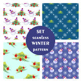 Set of seamless vector patterns. Seasonal winter different background with fir tree, snowmen and snowflakes. Graphic illustration. Series of sets of vector Royalty Free Stock Photography