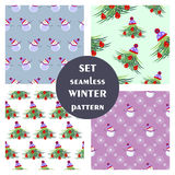 Set of seamless vector patterns. Seasonal winter different background with fir tree, snowmen and snowflakes. Graphic illustration. Series of sets of vector Royalty Free Stock Image