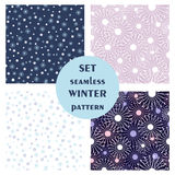 Set of seamless vector patterns. Seasonal winter different background with snowflakes. Graphic illustration. Series of sets of vector seamless patterns Stock Illustration