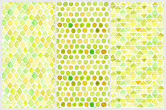 Set of seamless watercolor patterns. Simple geometric shapes. Hand drawn diamonds, triangles and circles. Illustration in soft yellow tones Royalty Free Stock Photo