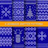 Seamless red and white knitted background. Set with seamless winter patterns. Blue and white knitted christmas background in scandinavian style. Vector royalty free illustration