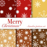 Set of seamless winter vector patterns with snowflakes. Stock Photos