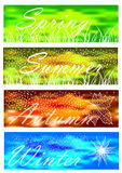 Set of seasonal banners on bokeh background. Color four seasons banners collection Royalty Free Stock Images