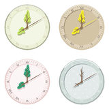Set of seasonal clock summer, autumn, winter and spring. Stock Image