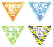 Set of Four Seasonal Sale Banners. Set of seasonal sale banners in triangular shape. summer, winter, spring, special. included EPS10 format Stock Images