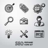Set of SEO handdrawn icons - target with arrow. Tag and world, magnifier, mail, support, idea, instruments, site. Vector illustration Stock Photos