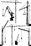 Set of seven building cranes Royalty Free Stock Photography