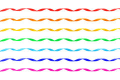 Set of seven curled different color satin ribbons stock image