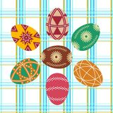 Set of seven Easter eggs on a checkered background Stock Images