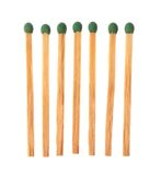 Set of seven green wooden matches on white background Royalty Free Stock Image