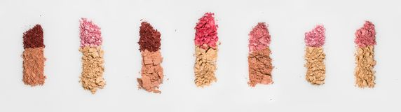 Set of seven lipsticks made from crashed face powder and blush,  on white background. Royalty Free Stock Photography