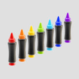 Set of seven rainbow colored wax crayons isolated Royalty Free Stock Image