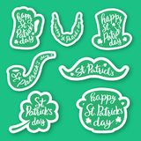 Set of seven stickers emblems with lettering: leaf clover, beer mug, mustaches, beard, hat , smoking pipe , pot of gold coins. Stock Images