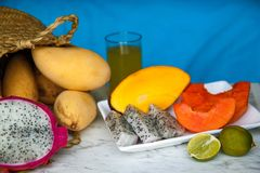 The set of several different fruits such as mango, dragon, lime, papaya. stock photos