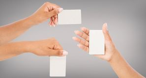Set several variants black hands hold business card isolated on grey background, blank,mockup stock photos